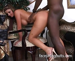 Busty golden-haired whore slobbers a dark ramrod