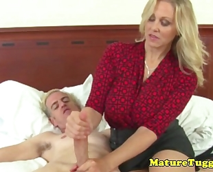 Busty aged milf receives cum on breasts after hj