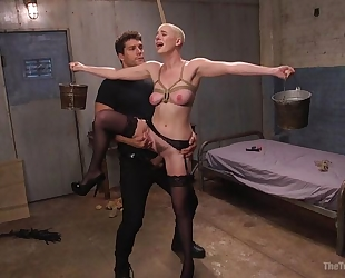 Bald-headed bombshell in black stockings shagged in BDSM action