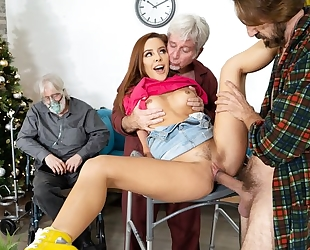 Slim redhead girl gets fucked by two horny grandpas